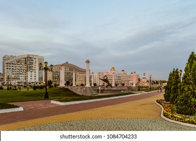 "Belgorod, Russia - September 05, 2017: Evening view of the Belgorod State University and left-bank residential neighborhood. Architectural composition of the fountain ""Nika"" (Nike Goddess)."