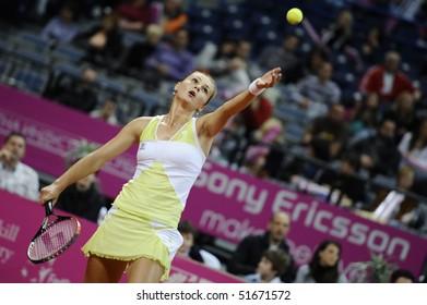 BELGRADE - APRIL 24: Magdalena Rybarikova serves the ball to Jelena Jankovic during Fed Cup World Group Play-off  in Belgrade Arena April 24, 2010 in Belgrade, Serbia.