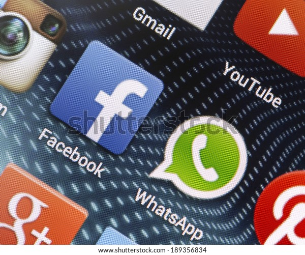 BELGRADE - APRIL 26, 2014 Popular social media icons Facebook, Whatsapp and other on smart phone screen close up