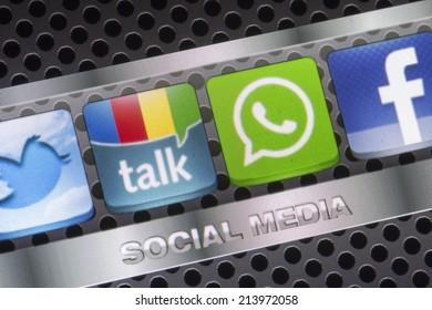BELGRADE - AUGUST 30, 2014 Social media icons Twitter, Whatsapp, Facebook, and Google talk on smart phone screen close up