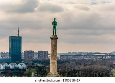 BELGRADE, BELGRADE/SERBIA- DECEMBER 23 2017 : The Pobednik monument on Kalemegdan park and city view in Belgrade, Serbia