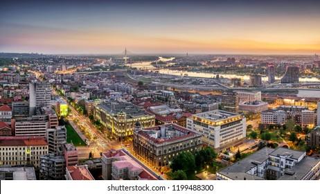 Belgrade downtown, Ada, Gazela bridges, Sava River Waterfront sunset dusk aerial panorama