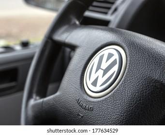 BELGRADE - FEBRUARY 19, 2014: Logo of popular German car manufacturer Volkswagen on steering wheel