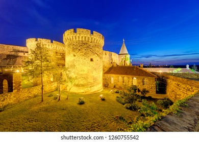 Belgrade fortress and old church with garden at night