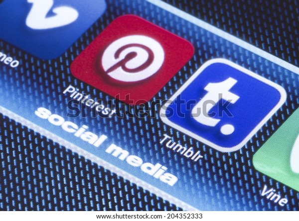 BELGRADE - JULY 11, 2014 Popular social media icons pinterest tumblr and other on smart phone screen close up