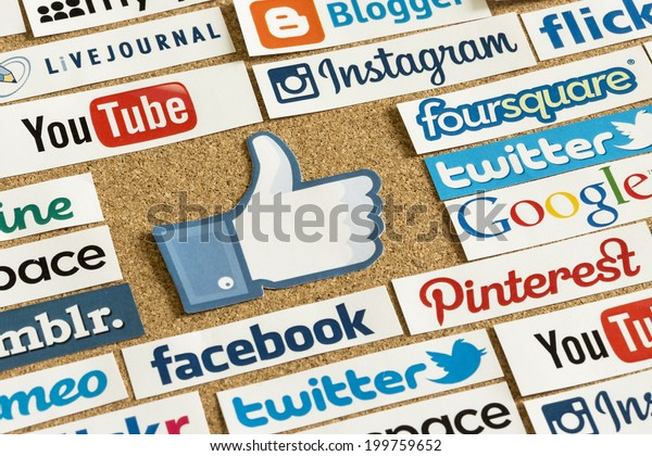 BELGRADE - JUNE 17, 2014 Social media website logos Facebook, Twitter and other with like logo printed on paper and pinned on cork bulletin board