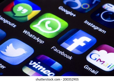 BELGRADE - JUNE 23, 2014 Popular social media icons whatsapp facebook and other on smart phone screen close up