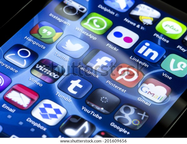 BELGRADE - JUNE 30, 2014 Popular social media icons Twitter, Facebook and other on smart phone screen close up