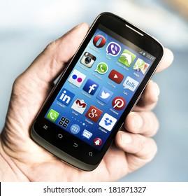 BELGRADE - MARCH 16, 2014 Popular Social media icons on smart phone screen
