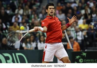 BELGRADE - MARCH 7: Novak Djokovic returns the ball during the Davis Cup World Group first round tennis match against John Isner in Belgrade Arena March 7, 2010 in Belgrade, Serbia.