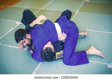 BELGRADE, SERBIA – 04 -12. OCTOBER 2018. Students practice BJJ Brazilian jiu-jitsu technique training on the AVI NARDIA KAPAP SELF DEFENSE SEMINAR