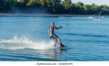 Belgrade, Serbia 06/04/2017: A cable powered wakeboarding park at Lake Ada Ciganlija. A young wakeboarder is riding his board on a popular lake in Belgrade, Serbia.