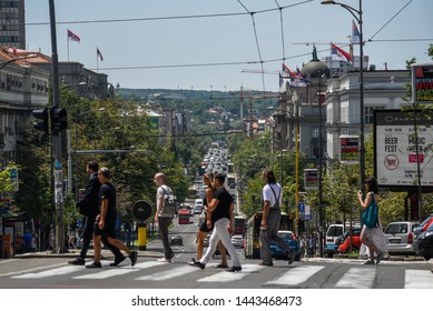BELGRADE, SERBIA - 1 JULY 2019:  - Belgrade traffic on the steep Kneza Milosa street with government buildings in the background