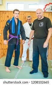 BELGRADE, SERBIA - 12. OCTOBER 2018. Student is promoted and gets BJJ Brazilian Jiu-Jitsu Purple Belt on the AVI NARDIA KAPAP SELF DEFENSE SEMINAR