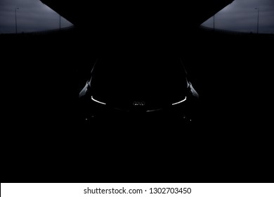 Belgrade, Serbia - 12.01.2018 / low key photo of SUV Kia Sportage 2.0 CRDI awd or 4x4, a dark picture, so that you can only see the contours of the car design. It looks like beast in the cave.