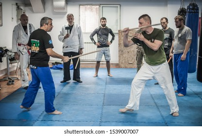 BELGRADE, SERBIA - 13. OCTOBER 2019. Kapap Krav Maga Sensei master instructor Avi Nardia demonstrates escrima stick-fighting to large group of students on Kapap Krav Maga seminar