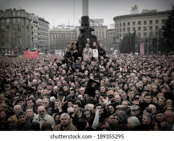 BELGRADE, SERBIA - 18, MARCH, 2006: People gather for the funeral procession of Slobodan Milosevics former president of the Federal Republic of Yugoslavia, in Belgrade, Serbia, on 18th of March, 2006.