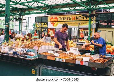 Belgrade, Serbia - 19 July, 2016: Different people at a farmers market Zeleni Venac in Belgrade, Serbia. Located on Trznica Pijaca Tvrdjava trade square