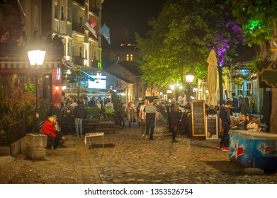 Belgrade, Serbia - 26.April 2017., Atmosphere and the mood during the warm spring night in most famous bohemian street, called Skadarlija, in Belgrade, Serbia. Soft focus, casual, everyday people.