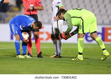 BELGRADE, SERBIA - 28 SEPTEMBER 2017: Junior Moraes puts the ball on 11 meters penalty point and Vladimir Stojkovic talks to him. UEFA Europa League group stage match Partizan - Dynamo.