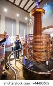 BELGRADE, Serbia - 5 Sept: Tourists take part in a Tesla Coil demonstration at the Nikola Tesla Museum in Belgrade on 5 Sept 2017.