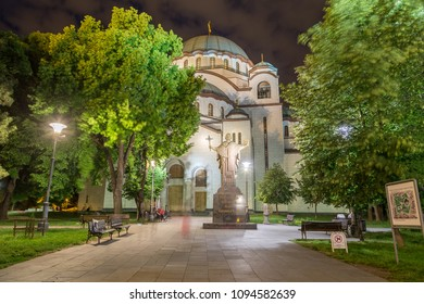 BELGRADE, SERBIA - 7TH MAY 2018: The outside of the side of Church of Saint Sava in Belgrade the capital of Serbia at night. People can be seen.