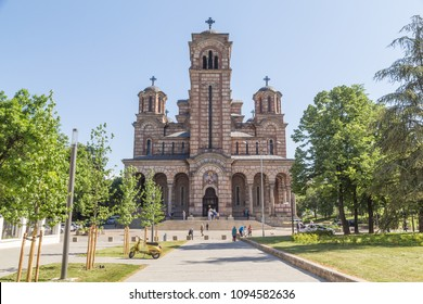 BELGRADE, SERBIA - 8TH MAY 2018: The front of St. Mark's Church, a Serbian Orthodox church in  Belgrade during the day. People can be seen outside.