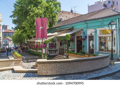 BELGRADE, SERBIA - 8TH MAY 2018: A view along Skadarlija (street) in Belgrade, a popular spot for trying traditional Serbian food at the many restaurants along the street. People can be seen.