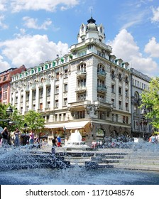 Belgrade, Serbia. April 03. 2012. Building on the corner of the Prince Mihailo street and Obilic square, and a fountain in front of which many passers-by make a picture.