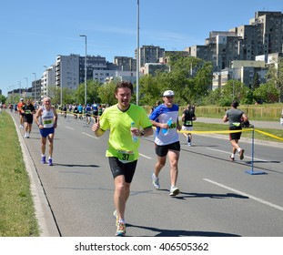 Belgrade, Serbia - April 16, 2016: 29th Belgrade Marathon. A group of runners during marathon race. Winners are Abel Kibet Rop, with time 2:23:58, and Stella Barsosio, 2:43:41, both from Kenia.