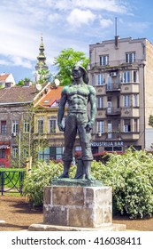 Belgrade, Serbia - April 18, 2016: A strong man statue by the Sava River coastline in central Belgrade, the Serbian capital on April 18, 2016.