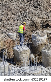 BELGRADE, SERBIA - APRIL 2, 2017: Workers break reinforced concrete with pneumatic jackhammer at a construction site.
