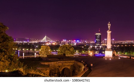 Belgrade, Serbia, April 2018 - Night shot from Kalemegdan fortress over the city Belgrade with river, Victor monument and Mehmet Pasa drinking fountain