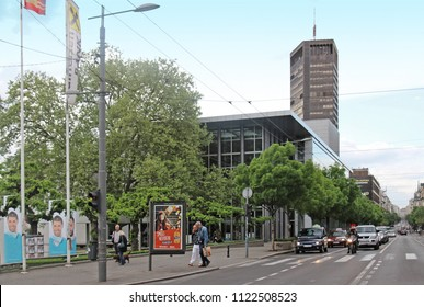 Belgrade, Serbia - April 28, 2015: Kralja Milana street with tall skyscraper Belgrade Palace in the back and Yugoslav Drama Theatre building on the side. It shows busy car traffic and people walking.