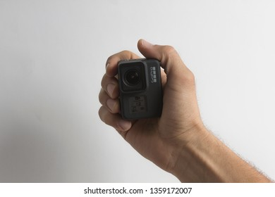 Belgrade, Serbia - April, 3 2019: GoPro Hero 7 Black action camera in the male hand isolated on the white background.