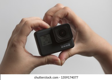 Belgrade, Serbia - April, 3 2019: GoPro Hero 7 Black action camera in the female hands as heart isolated on the white background.