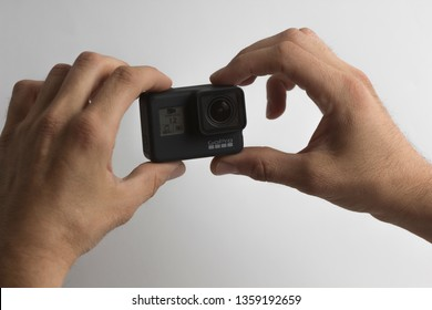 Belgrade, Serbia - April, 3 2019: GoPro Hero 7 Black action camera in the male hands isolated on the white background.