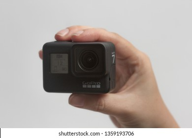 Belgrade, Serbia - April, 3 2019: GoPro Hero 7 Black action camera in the female hand isolated on the white background.