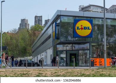 Belgrade, Serbia - April 7, 2019: Lidl supermarket in Konjarnik neighborhood. People in front of the store. Lidl is a German global discount supermarket chain.