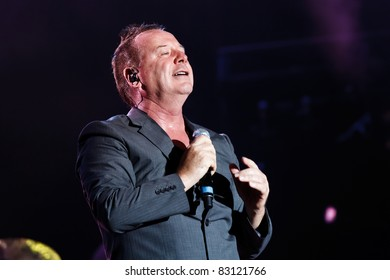 """BELGRADE, SERBIA - AUGUST 18 : Scottish pop rock music band """"SIMPLE MINDS"""" performs at the Belgrade BeerFest 2011 at """"Usce"""" on August 18, 2011 in Belgrade, Serbia."""