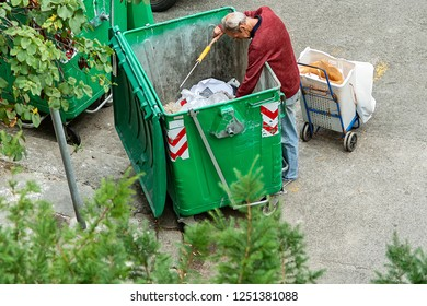 Belgrade, Serbia - August 28, 2018: Poor people find or searching garbage for sell to reuse and recycle in landfill. This life and living.