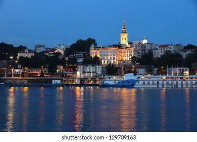 Belgrade, Serbia - capital city view at night. Illuminated cityscape.