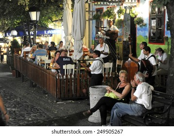 BELGRADE, SERBIA - CIRCA AUGUST 2013: People enjoys in restaurants in famous bohemian quarter Skadarlija, circa August 2013 in Belgrade