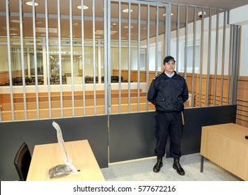 BELGRADE, SERBIA - CIRCA FEBRUARY 2009: Police officer guards prison courtroom, circa February 2009 in Belgrade