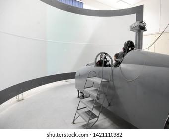 BELGRADE, SERBIA - CIRCA FEBRUARY 2019: Student pilot trains maneuvers in a fighter jet flying simulator cockpit