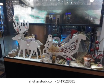 BELGRADE, SERBIA - CIRCA JANUARY 2019: Display with reindeers and bobsled decorated for New Year holidays