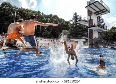 BELGRADE, SERBIA - CIRCA JULY 2009: Group Of Friends Jumping Into Outdoor Pool, circa July 2009. in Belgrade