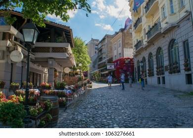 BELGRADE, SERBIA - CIRCA JULY 2017: Unidentified people walk through the bohemian Skadarlija neighbourhood