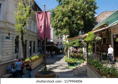 BELGRADE, SERBIA - CIRCA JULY 2017: Unidentified people walk through the Skadarlija neighbourhood