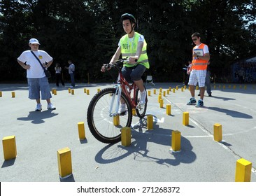BELGRADE, SERBIA - CIRCA MAY 2011: School children practices bicycle driving skills at learning competition about traffic, circa May 2011 in Belgrade